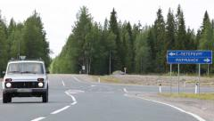 Car turns to the turnoff from the Kola route. Russia Stock Footage