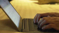 Close up of man hands using laptop on bed at night Stock Footage