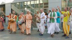 People from the Hare Krishna movement dancing and singing on the street 2 Stock Footage