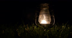 Old kerosene lamp on grass at night. Close-up. - stock footage