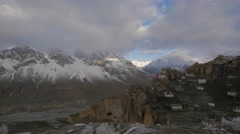 TIMELAPSE village after snow with snow capped mountains,Dankhar,Spiti,India Stock Footage