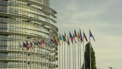 Establishing shot of European Union country flags with European Parliament Stock Footage