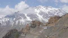 TIMELAPSE village and snow capped mountain with clouds,Dankhar,Spiti,India - stock footage