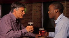 Colleagues having a drink after work Stock Footage