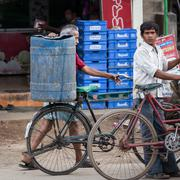 MADURAI, INDIA-FEBRUARY 15: Man with a bike 15, 2013 in Madurai, India. The m - stock photo