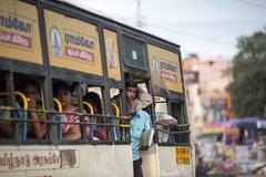 MADURAI, INDIA-FEBRUARY 15: Indian bus 15, 2013 in Madurai, India. People in  - stock photo