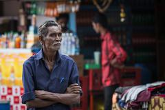 MADURAI, INDIA-FEBRUARY 15: Trader on the street of Indian town on February 1 - stock photo