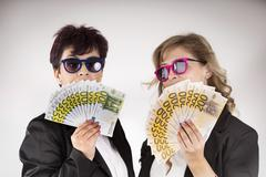Partners shows the banonotes earned Stock Photos
