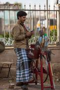 MADURAI, INDIA-FEBRUARY 16: Trader on the street of Indian town on February 1 - stock photo