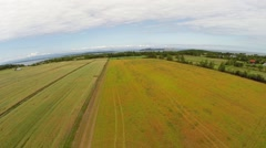 Aerial open up view over crop fields on shoreline in Gaspe Peninsula Stock Footage