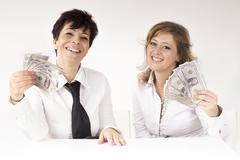 Partners shows the dollars earned Stock Photos