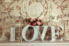LOVE letters on floral background - stock photo