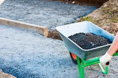 wheelbarrow with gravel - stock photo