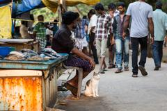 KOCHIN, INDIA-FEBRUARY 25: Trader on the street of Indian town on February 25 - stock photo