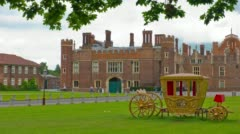 Hampton Court Royal Palace and carriage, London, England Stock Footage