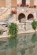 Old thermal baths in Bagno Vignoni Italy - stock photo