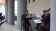 musicians play classical music with passion in street. 4K - stock footage