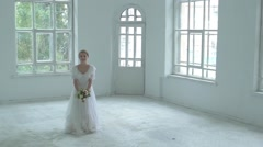 Beautiful girl in white dress throw up the bouquet, slow motion Stock Footage