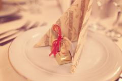 Wedding favor on plate - stock photo