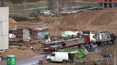 Workers builders unload blocks from truck trailer. 4K Stock Footage