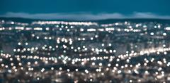 Beautiful abstract blue circular bokeh background, city lights with horizon a Kuvituskuvat