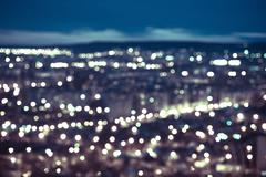 Stock Photo of abstract blue circular bokeh background, city lights in the twilight with hor