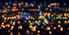 Beautiful city lights background with blurring bokeh in twilight, panorama Kuvituskuvat