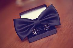 Black cuff links and bowtie Stock Photos