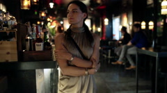 Woman going to her friends in the pub, steadycam shot Stock Footage