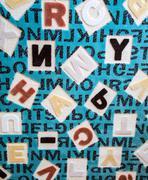 Alphabets on a Fabric Carpet Surface Stock Photos