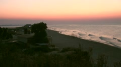 Sunrise at sea panorama of beach and coastline with the houses,  wave Stock Footage