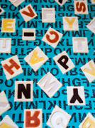 Stock Photo of Alphabets on a Fabric Carpet Surface