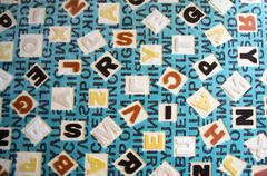 Alphabets on a Fabric Carpet Surface - stock photo