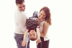 Parents playing with their child Stock Photos
