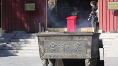 Lighting incense, Yonghe Lamasery, Beijing Stock Footage