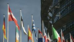 Flag of the European Union waving in the wind with Greek flag in the center Stock Footage