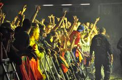 Party people in the golden circle at a concert - stock photo