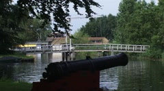 Historic cannon + drawbridge across moat HASSELT FORTIFICATION - stock footage