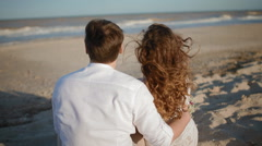 Young caucasian couple look at the sea - stock footage