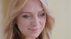 Close up portrait of blond young woman Stock Footage