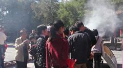 Buddhist temple, burning incense, China Stock Footage
