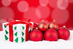 Christmas card gift decoration with gifts and red balls - stock photo