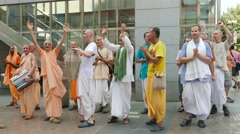 People from the Hare Krishna movement dancing and singing on the street 4 Stock Footage