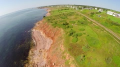 Stock Video Footage of Aerial travelling along shoreline in Gaspe Peninsula
