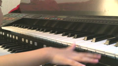 Cute asian boy learning to play electone - stock footage