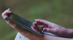 Hands of woman its slide in a tablet to watch some photos Stock Footage