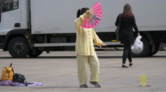 Asian woman with a pink hand fan in Berlin Stock Footage