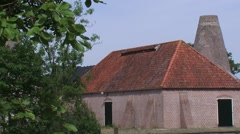 Renovated brick barn with lime kiln, where lime was extracted from seashells Stock Footage