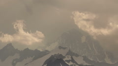 Storm covering high mountain peak Finsteraarhorn Bernese Oberland time lapse - stock footage