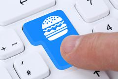 Ordering hamburger cheeseburger online fast food order delivery fastfood inte - stock photo